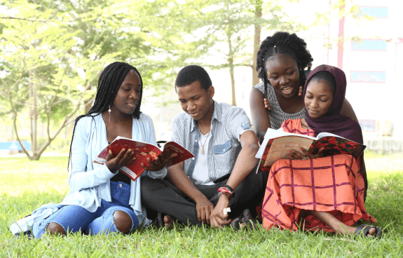Picture of students reading under tree